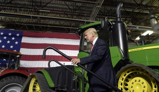 President Donald Trump walks on stage to speaks at Kirkwood Community College, which is recognized by the White House as a major center of agricultural innovation, during a visit to the campus in Cedar Rapids, Iowa, Wednesday, June 21, 2017. This is Trump's first visit to Iowa since the election. (AP Photo/Susan Walsh)