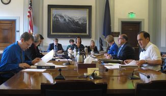 A conference committee composed of members of an Alaska House and Senate meet to discuss budget items on Thursday, June 22, 2017, in Juneau, Alaska. (AP Photo/Becky Bohrer)