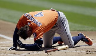 Houston Astros' George Springer falls after being hit by a pitch thrown by Oakland Athletics pitcher Jesse Hahn in the first inning of a baseball game Thursday, June 22, 2017, in Oakland, Calif. Springer left the game. (AP Photo/Ben Margot)