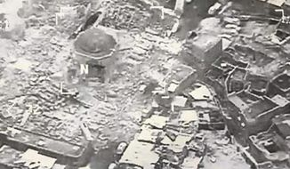This image provided by U.S. CENTCOM shows al-Nuri mosque destroyed by the Islamic State group, in Mosul, Iraq, Wednesday, June 21, 2017. The Islamic State group destroyed the mosque and its iconic leaning minaret known as al-Hadba when fighters detonated explosives inside the structures Wednesday night, Iraq's Ministry of Defense said. Iraqi Prime Minister Haider al-Abadi tweeted early Thursday, June 22, 2017 that the destruction was an admission by the militants that they are losing the fight for Iraq's second-largest city. (U.S. CENTCOM via AP)