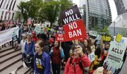 In this May 15, 2017, file photo, protesters wave signs and chant during a demonstration against President Donald Trump's revised travel ban outside a federal courthouse in Seattle. (AP Photo/Ted S. Warren, file)