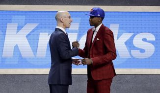 Frank Ntilikina is congratulated by NBA Commissioner Adam Silver after being selected by the New York Knicks as the eighth pick overall during the NBA basketball draft, Thursday, June 22, 2017, in New York. (AP Photo/Frank Franklin II)