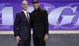 Lonzo Ball, right, poses for a photo with NBA Commissioner Adam Silver after being selected by the Los Angeles Lakers as the No. 2 overall pick during the NBA basketball draft, Thursday, June 22, 2017, in New York. (AP Photo/Frank Franklin II)