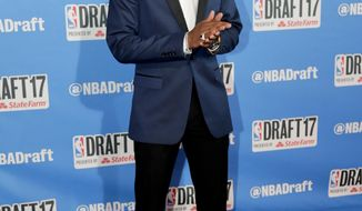 Kentucky's Malik Monk stops for photos while walking the red carpet before the start of the NBA basketball draft, Thursday, June 22, 2017, in New York. (AP Photo/Frank Franklin II)