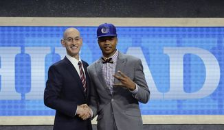 Washington's Markelle Fultz, right, poses for a photo with NBA Commissioner Adam Silver after being selected by the Philadelphia 76ers as the No. 1 pick overall during the NBA basketball draft, Thursday, June 22, 2017, in New York. (AP Photo/Frank Franklin II)