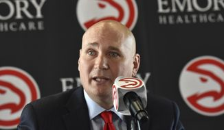 FILE - In this June 2, 2017, file photo, Atlanta Hawks general manager Travis Schlenk speaks during an introductory press conference at Philips Arena in Atlanta. After dumping Dwight Howard and facing the loss of four-time All-Star Paul Millsap, the Hawks could be heading into a major overhaul under new general manager Travis Schlenk as they select 19th in the NBA draft. (Hyosub Shin/Atlanta Journal-Constitution via AP, File)