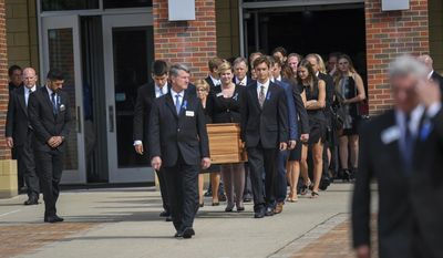 The casket of Otto Warmbier is carried from Wyoming High School after his funeral, Thursday, June 22, 2017, in Wyoming, Ohio. Warmbier, a 22-year-old University of Virginia undergraduate student who was sentenced in March 2016 to 15 years in prison with hard labor in North Korea, died this week, days after returning to the United States. (AP Photo/Bryan Woolston)