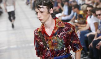 A model wears a creation as part of Louis Vuitton Men's Spring Summer 2018 fashion collection, presented in Paris, France, Thursday, June 22, 2017. (AP Photo/Francois Mori)