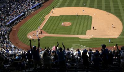 Fans celebrate as Kansas City Royals' Salvador Perez runs the bases after hitting a grand slam during the eighth inning of a baseball game against the Boston Red Sox Wednesday, June 21, 2017, in Kansas City, Mo. (AP Photo/Charlie Riedel)