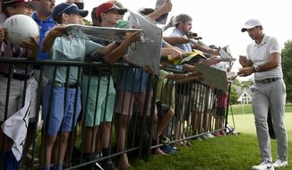 Jason Day signs autographs at the Travelers Championship at TPC River Highlands, Wednesday, June 21, 2017 in Cromwell, Conn. (John Woike/Hartford Courant via AP)