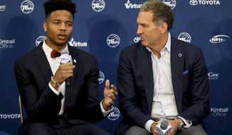Philadelphia 76ers' draft pick Markelle Fultz, left, speaks during a news conference with team president Bryan Colangelo at the team's NBA basketball training complex, Friday, June 23, 2017, in Camden, NJ. (AP Photo/Matt Slocum)
