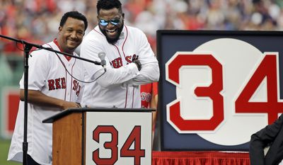 Boston Red Sox baseball great David Ortiz, right, laughs with Hall of Fame pitcher Pedro Martinez, Friday, June 23, 2017, at Fenway Park in Boston as the team retired Ortiz's jersey No. 34 worn when he led the franchise to three World Series titles. It is the 11th number retired by the Red Sox. (AP Photo/Elise Amendola)