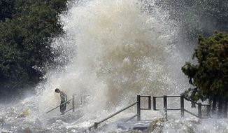 Wth a rising tide, strong southerly winds from Tropical Depression Cindy lash the lakefront Thursday, June 22, 2017 in Mandeville, La. (David Grunfeld/NOLA.com The Times-Picayune via AP)