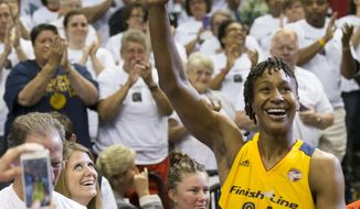 FILE - In this Sept. 18, 2016, file photo, Indiana Fever's Tamika Catchings acknowledges the crowd during a WNBA basketball game against the Dallas Wings in Indianapolis. Retirement has been treating Catchings well, although she's busier now then during her stellar 15-year career with the Indiana Fever which came to an end last season. Catchings will receive one more honor from the Fever on Saturday, June 24, 2017, when the team retires her No. 24 jersey. (Robert Scheer/The Indianapolis Star via AP, File)