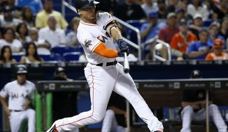 Miami Marlins' Giancarlo Stanton hits a home run during the third inning of a baseball game against the Chicago Cubs, Friday, June 23, 2017, in Miami. (AP Photo/Wilfredo Lee)