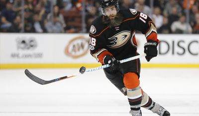 FILE - In this March 15, 2017, file photo, Anaheim Ducks' Patrick Eaves moves the puck during the team's NHL hockey game against the St. Louis Blues in Anaheim, Calif. Eaves has agreed to a three-year, $9.45 million contract to stay with the Anaheim Ducks. Anaheim announced the deal Friday night during the NHL draft. (AP Photo/Jae C. Hong, File)