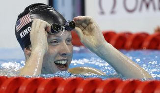 FILE - In this Aug. 8, 2016, file photo, United States' Lilly King celebrates after winning the gold medal in the women's 100-meter breaststroke final at the 2016 Summer Olympics in Rio de Janeiro, Brazil. King is always willing to offer up an opinion. She doesn't care if it makes headlines, doesn't mind rubbing people the wrong way.  In the staid world of swimming, that makes her really stand out. She just wishes there were more athletes willing to take a stand. (AP Photo/Michael Sohn, File)