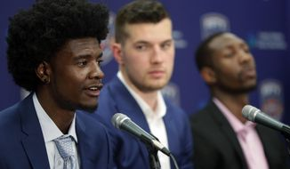 Phoenix Suns first-round draft pick Josh Jackson speaks to the media, Friday, June 23, 2017, in Phoenix as the NBA basketball team's second-round picks Davon Reed, right, and Alec Peters listen. (AP Photo/Matt York)