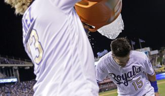 Kansas City Royals' Whit Merrifield (15) is doused by Salvador Perez after the team's baseball game against the Toronto Blue Jays on Friday, June 23, 2017, in Kansas City, Mo. The Royals won 5-4. (AP Photo/Charlie Riedel)