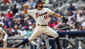 Atlanta Braves starting pitcher R.A. Dickey (19) works in the first inning of a baseball game against the Milwaukee Brewers on Saturday, June 24, 2017, in Atlanta. (AP Photo/Danny Karnik)