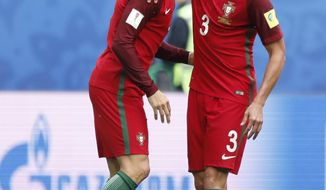 Portugal's Cristiano Ronaldo, left, celebrates with Pepe after scoring his side's first goal during the Confederations Cup, Group A soccer match between New Zealand and Portugal, at the St. Petersburg Stadium, Russia, Saturday, June 24, 2017. (AP Photo/Pavel Golovkin)