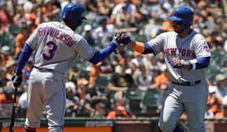 New York Mets' Rene Rivera, right, is met at the plate by teammate Curtis Granderson after hitting a solo home run against the San Francisco Giants during the fourth inning of a baseball game Sunday, June 25, 2017, in San Francisco. (AP Photo/Marcio Jose Sanchez)