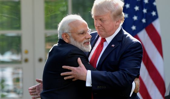 """President Trump and Indian Prime Minister Narendra Modi made statements in the Rose Garden of the White House Monday, in which the two leaders renewed vows to fight Islamic extremism and increase military cooperation. """"We are both determined to destroy terrorist organizations and the radical ideology that drives them,"""" Mr. Trump said. (Associated Press)"""