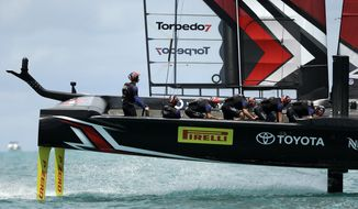Emirates Team New Zealand helmsman Peter Burling steers his boat in race nine against Oracle Team USA during America's Cup sailing competition Monday, June 26, 2017, in Hamilton, Bermuda. (AP Photo/Gregory Bull)