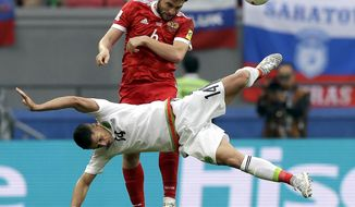 Mexico's Javier Hernandez, front, and Russia's Georgii Dzhikiia, rear, challenge for the ball during the Confederations Cup, Group A soccer match between Mexico and Russia, at the Kazan Arena, Russia, Saturday, June 24, 2017. Mexico defeated Russia by 2-1. (AP Photo/Thanassis Stavrakis)