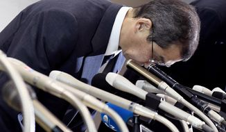 Japanese air bag maker Takata Corp. CEO Shigehisa Takada bows at the beginning of a press conference in Tokyo, Monday, June 26, 2017.  Takata Corp. has filed for bankruptcy protection in Tokyo and the U.S., overwhelmed by lawsuits and recall costs related to its production of defective air bag inflators. (Akiko Matsushita/Kyodo News via AP)