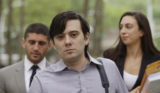 In this Monday, June 19, 2017, file photo, former Turing Pharmaceuticals CEO Martin Shkreli arrives at Brooklyn federal court with members of his legal team, in New York, for a pretrial conference in his securities fraud trial. Shkreli's trial begins Monday, June 26. (AP Photo/Mark Lennihan, File)