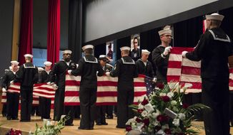 In this photo released by U.S. Navy, sailors fold seven U.S. flags during a memorial ceremony at Fleet Activities (FLEACT) Yokosuka, south of Tokyo, Tuesday, June 27, 2017, for seven sailors assigned to USS Fitzgerald who were killed in the June 17 collision. The U.S. Navy has paid tribute to the sailors killed as their warship collided with a merchant ship off Japan this month. The USS Fitzgerald and the Philippine-flagged container collided in the Japanese waters off Yokosuka in the pre-dawn hours of June 17. (Mass Communication Specialist 2nd Class Raymond D. Diaz III/U.S. Navy via AP)