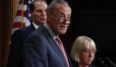 """Senate Minority Leader Chuck Schumer, D-N.Y., center, joined by Sen. Patty Murray, D-Wash., right, and Sen. Ron Wyden, D-Ore., left, speaks during a new conference on Capitol Hill in Washington, Monday, June 26, 2017, about the Senate Republicans health care bill. Senate Republicans unveil a revised health care bill in hopes of securing support from wavering GOP lawmakers, including one who calls the drive to whip his party's bill through the Senate this week """"a little offensive."""" (AP Photo/Carolyn Kaster)"""