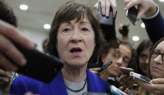 """FILE - In this June 22, 2017 file photo, Sen. Susan Collins, R-Maine speaks amid a crush of reporters on Capitol Hill in Washington. Somewhere along the way, the Republican crusade to repeal """"Obamacare"""" also turned into an effort to limit the future growth of Medicaid. That bit of mission creep is complicating prospects for the GOP, and could lead to deadlock.  (AP Photo/J. Scott Applewhite, File)"""