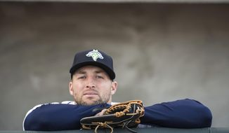 FILE- In this April 6, 2017, file photo, Columbia Fireflies outfielder Tim Tebow looks out from the dugout before the team's minor league baseball game against the Augusta GreenJackets in Columbia, S.C. Tebow has been promoted to the New York Mets' high Class A affiliate in St. Lucie, Fla. General manager Sandy Alderson announced the move before the Mets' 8-2 win at San Francisco on Sunday, June 25. (AP Photo/Sean Rayford, File)