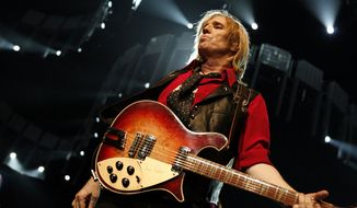 Tom Petty of Tom  Petty and The Heartbreakers performs at Madison Square Garden Tuesday, June 20, 2006 in New York.  (AP Photo/Jason DeCrow)