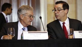 Treasury Secretary Steven Mnuchin, right, speaks with Federal Reserve Chairman Jerome Powell, at the start of a meeting of the Financial Stability Oversight Council, Tuesday, Oct. 16, 2018, at the Treasury Department in Washington. (AP Photo/Jacquelyn Martin) ** FILE **