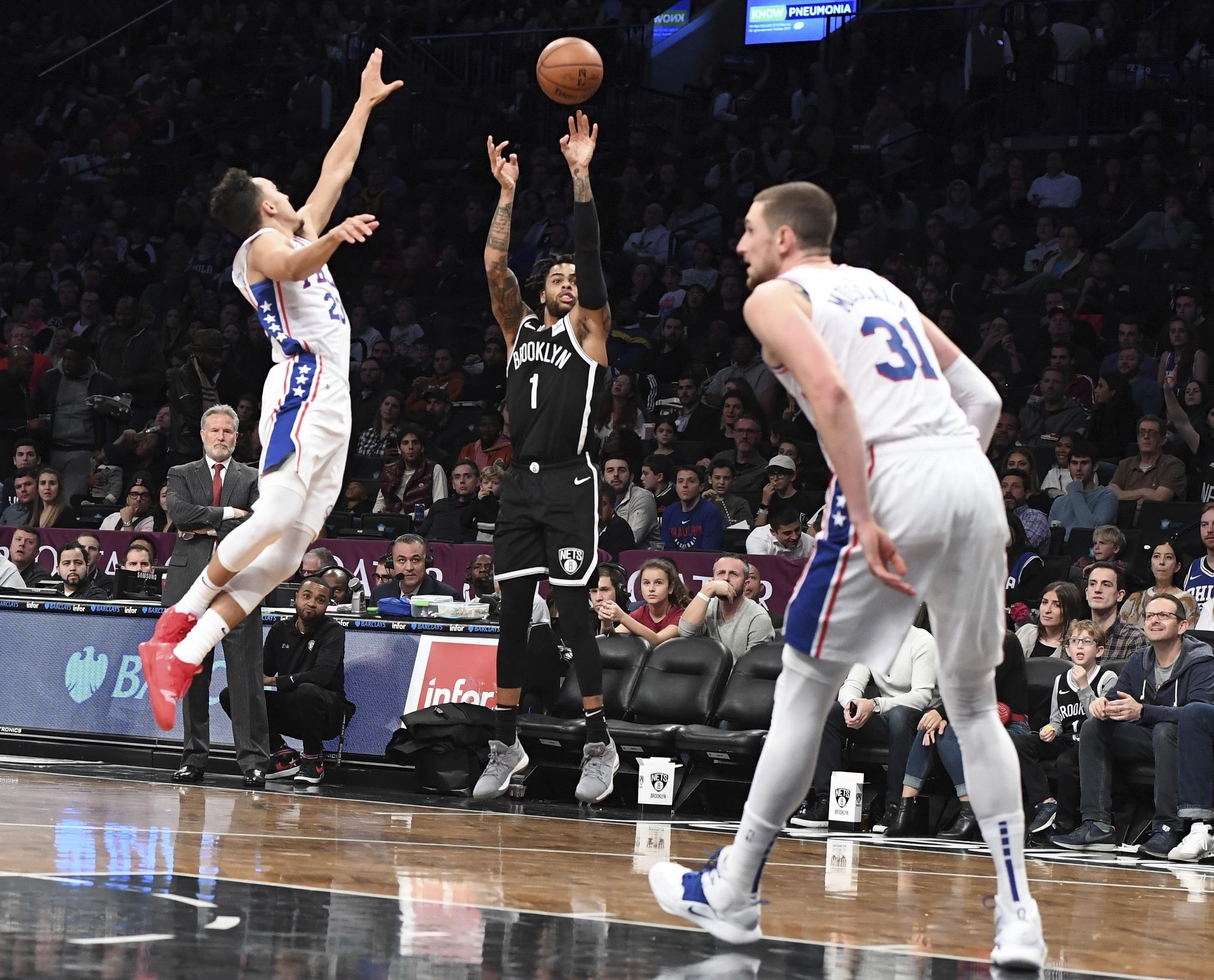 Russell scores 21, Nets defeat sloppy Sixers 122-97