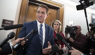 In this Dec. 6, 2018, file photo, Sen. Jeff Flake, R-Ariz., speaks with reporters on Capitol Hill in Washington. (AP Photo/J. Scott Applewhite, File)