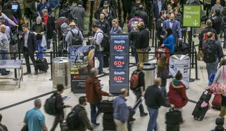 Security lines at Hartsfield-Jackson International Airport in Atlanta stretch more than an hour-long amid the partial federal shutdown, causing some travelers to miss flights, Monday morning, Jan. 14, 2019. (John Spink/Atlanta Journal-Constitution via AP) ** FILE **
