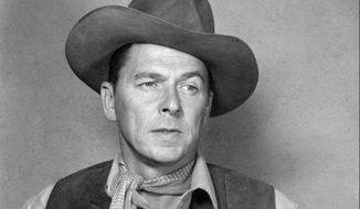 """**  FILE**  Actor Ronald Reagan loads his gun in the 1953 western film """"Law and Order"""", in which Reagan plays a retired U.S. marshall who can't hang up his holster.  It is reported that Reagan died on Saturday, June 5, 2004 at 93.     (AP Photo)"""