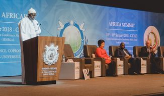 Cheikh Mansour Diouf, President, Africa Summit 2018 Steering Committee, addresses the audience Jan. 18, 2018. Seated (left to right) Universal Peace Federation co-founder Dr. Hak Ja Han Moon, Senegal President H.E. Macky Sall and UPF International Chairman Dr. Thomas G. Walsh. (Photo credit: UPF-International)