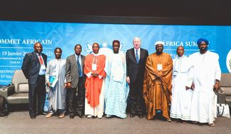 Clergy from several faiths, joined by Universal Peace Federation International Chairman Thomas G. Walsh (fourth from right), stressed interfaith cooperation as part of the solution to benefit Africa's families, communities and culture. (Photo credit: UPF-International)