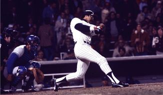 Yankees' slugger Reggie Jackson connects for his third home run in the eighth inning off a pitch from the Dodgers' Charlie Hough during game 6 of the World Series against the Los Angeles Dodgers at Yankee Stadium in New York on Oct. 18, 1977.  New York won the game 8-4, for their 21st World Series championship.  (AP Photo)