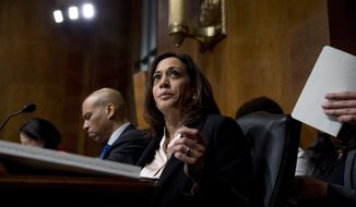 Democratic presidential candidates Sen. Cory Booker, D-N.J., left, and Sen. Kamala Harris, D-Calif., center, listen as Attorney General William Barr testifies during a Senate Judiciary Committee hearing on Capitol Hill in Washington, Wednesday, May 1, 2019, on the Mueller Report. (AP Photo/Andrew Harnik)