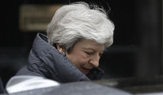 British Prime Minister Theresa May leaves 10 Downing Street in London, to attend Prime Minister's Questions at the Houses of Parliament, Wednesday, May 8, 2019. (AP Photo/Matt Dunham)