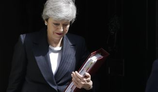 Britain's Prime Minister Theresa May leaves 10 Downing Street to attend the weekly session of Prime Ministers Questions in Parliament in London, Wednesday, May 22, 2019. (AP Photo/Kirsty Wigglesworth)