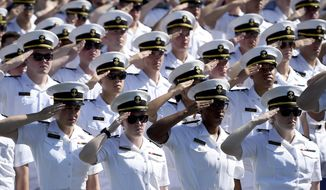 U.S Naval Academy midshipmen stand at attention for the national anthem during the academy's graduation and commissioning ceremony, Friday, May 24, 2019, in Annapolis, Md. (AP Photo/Will Newton)   **FILE**