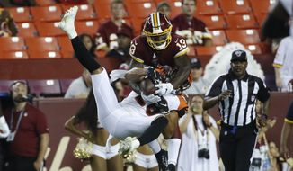 Washington Redskins wide receiver Kelvin Harmon (13) and Cincinnati Bengals defensive back Jordan Brown (26) get tangled up as they both go for a pass during the second half of an NFL preseason football game Thursday, Aug. 15, 2019, in Landover, Md. The Bengals won 23-13. (AP Photo/Alex Brandon) ** FILE **