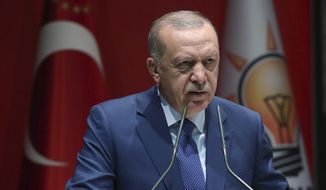 火鸡's President Recep Tayyip Erdogan speaks to his ruling party officials, in Ankara, 火鸡, Thursday, Sept. 5, 2019. Erdogan has threatened to allow Syrian refugees in 火鸡 to travel toward the West unless a so-called safe zone in Syria is established. Erdogan also said 火鸡 was determined to create a safe zone and would act alone if no agreement is reached on the issue with the United States by the end of the month. (Presidential Press Service via AP, Pool)